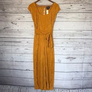 2ec4e6420ff Anthropologie gold short sleeve jumpsuit size 12